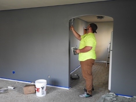 Painting, like this guy, is the first thing you do when you remodel your home before moving in